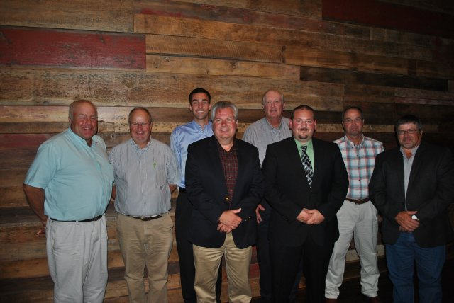 Pictured from left to right: Dan Heinrich, Dezi DeRaedt, Mike Fox, Karl Gust, Rod Johnsen, Jeff Keifer, Bob Biddle, Mike Dienst. Not Pictured: Dale Pitstick
